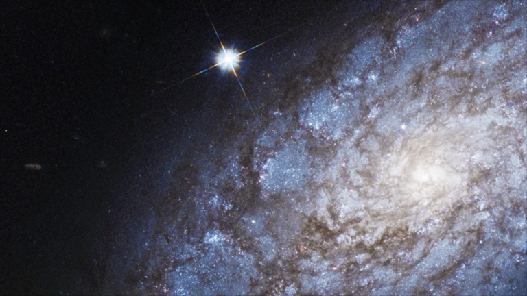 nasas-hubble-reveals-breathtaking-photo-of-galaxy-embracing-baby-stars-20-million-light-years-away