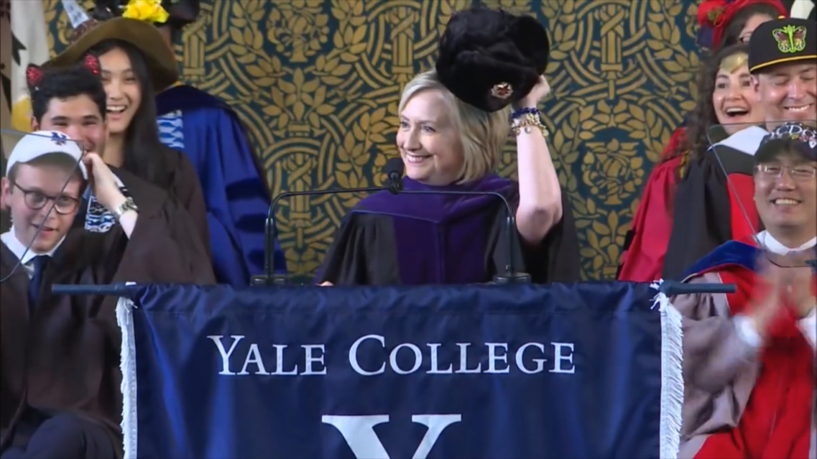 hillary-clinton-puts-on-russian-hat-during-yale-class-day-speech